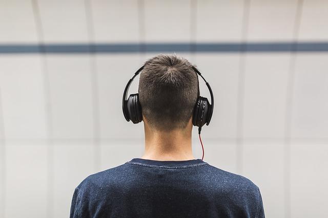 man with headphones facing away